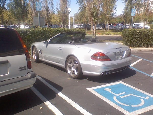 Steve jobs is parked in a handicapped spot and his car is for Mercedes benz employment