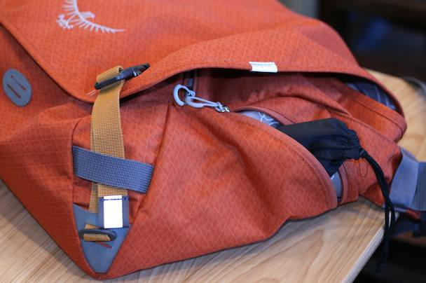 The zippered side pocket is perfect for stowing sunglasses. Note the swapped out orange buckle webbing; probably makes a bigger splash with the bag's other available colors, black and khaki
