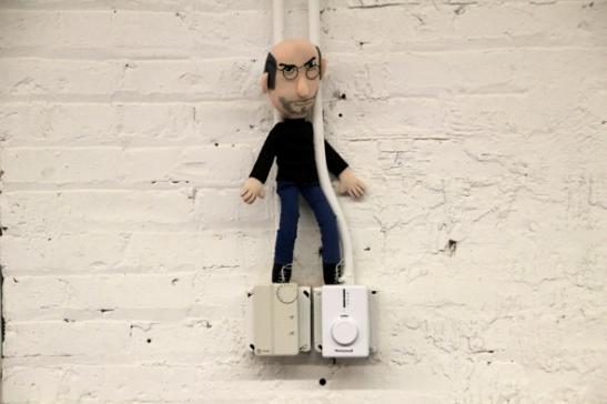 Of course every serious design shop needs a steve jobs doll
