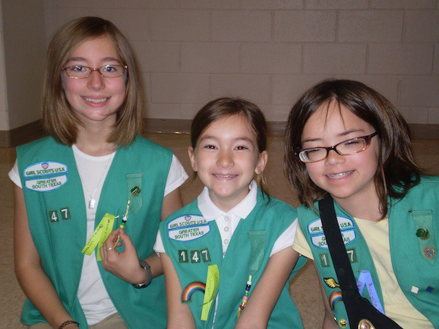 These adorable Girl Scouts haven't hacked anything. They just sell cookies.