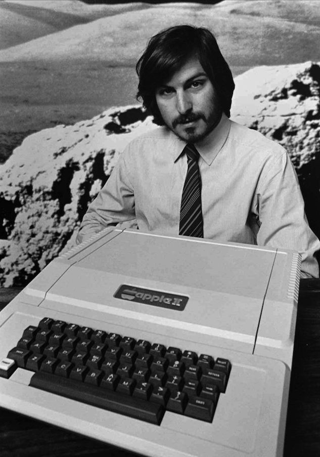 Steve Jobs shows off the Apple II.