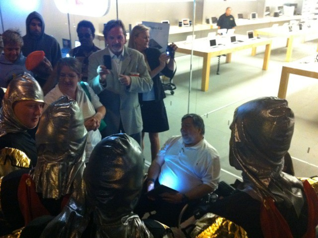 Woz is first in line for an iPhone 4S at Apple's Los Gatos store. Here he is surrounded by a group of drunken knights from England, according to our stringer Mike Elgan.