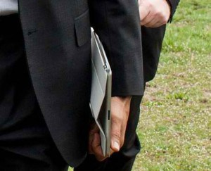 man holding iPad with case