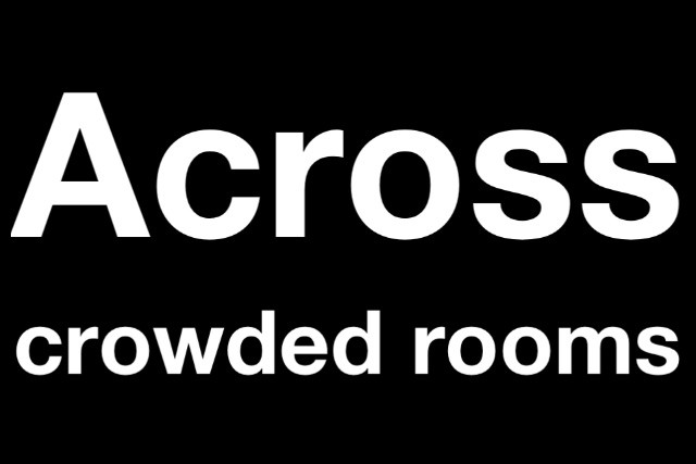 Across crowded rooms