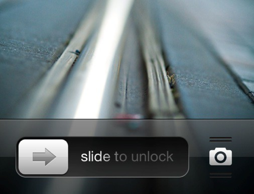 Is that a camera shortcut on an iOS 5.0.1 lock screen?