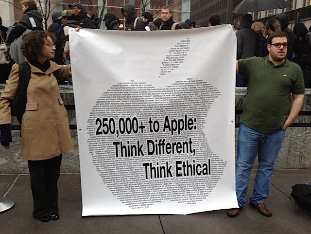 Change.org protesters outside an Apple store.