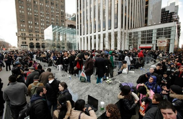 Customers line up for the new iPad outside of Apple's Fifth Avenue store.