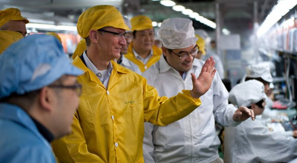 Tim Cook greeting Foxconn workers in China. Photo: Apple