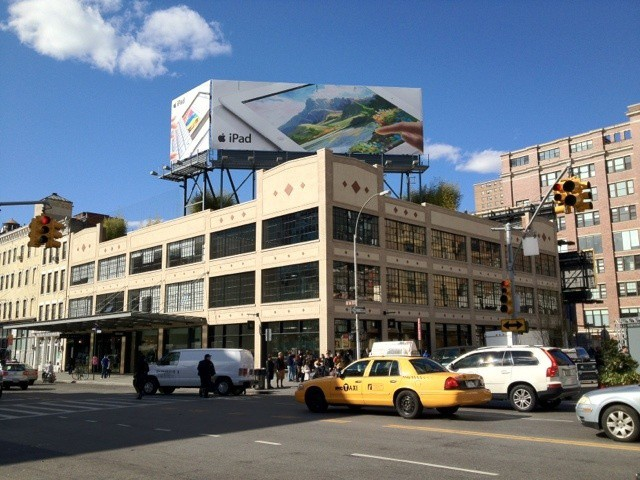 An ad for the new iPad atop NYC's 14th Street Apple Store. Photo by Dan Frommer