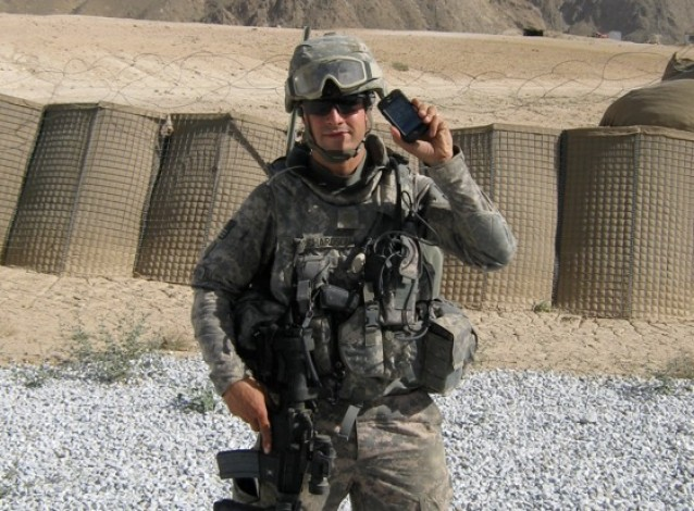 AT&T will unlock in-contract iPhones for deployed service men so that the handset can be used with other carriers abroad.
