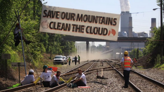 Environmental protesters in 2012 block coal trains meant to power Apple's Maiden, NC data facility.
