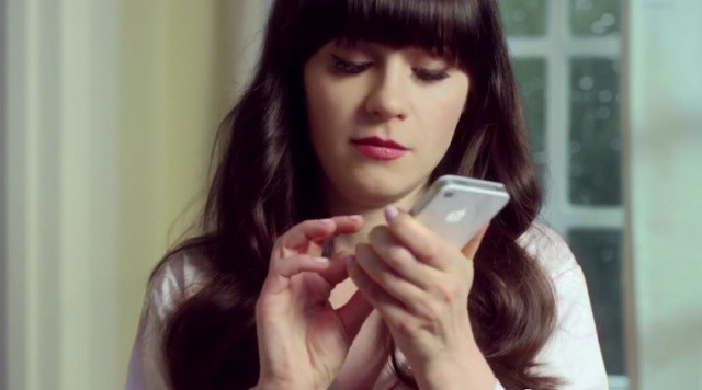 Zooey loves her iPhone.