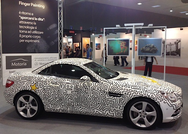 The fingerpainted car on display at Expo Arte in Italy. Courtesy Matthew Watkins.
