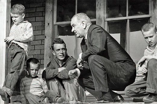 Time Magazine's iconic photo of LBJ on Tom Fletcher's front porch in Martin County, Kentucky, in April 1964, where he declared the War on Poverty.
