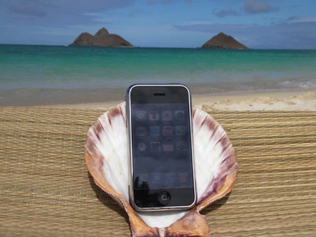 Using personal iPhones and iPads in the office, leads many people to work from them while on vacation.