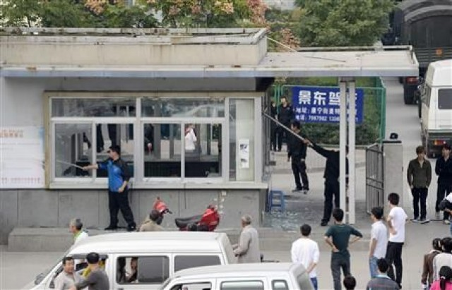 The riot resulted in broken windows at the Foxconn factory.