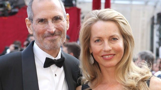 Who's that good looking guy standing next to Laurene Powell Jobs?
