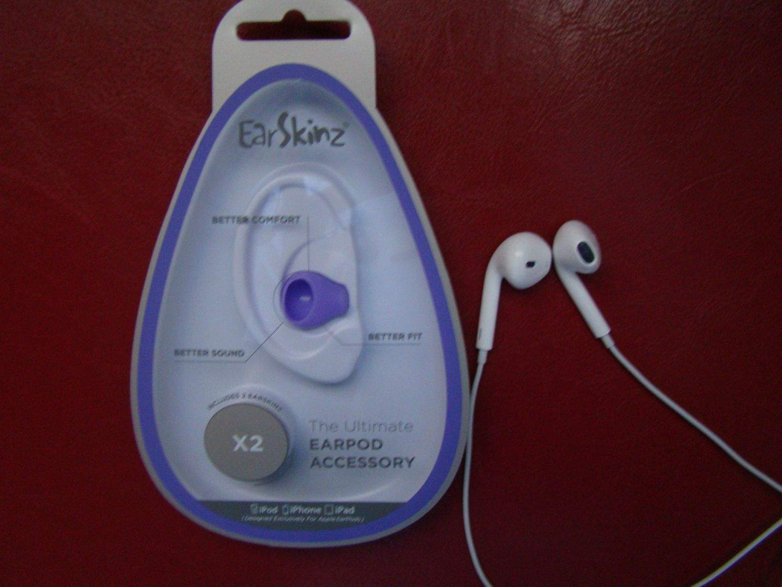 b01809a6b10 I opened the attractive packaging for a pair of purple EarSkinz, and  started to put them on my white set of Apple EarPods. The silicone is thick  enough to ...