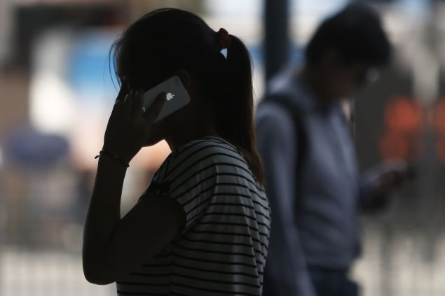 woman-talking-on-iphone-reuters-635