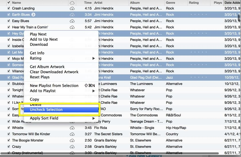 how do you uncheck all songs in itunes at once on a mac
