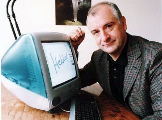 Douglas Adams, pictured with his iMac in the late 1990s.