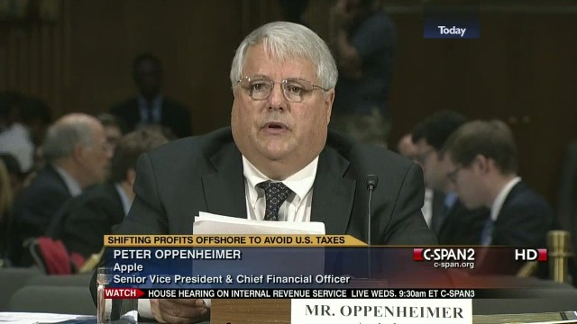 Apple CFO Peter Oppenheimer testifying before a congressional panel in 2013