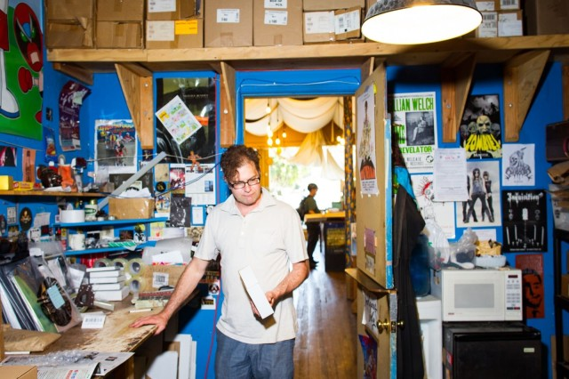 Jim Haynes, assistant manager at Aquarius Records in San Francisco, spends his morning in the back room boxing up orders from across the country.