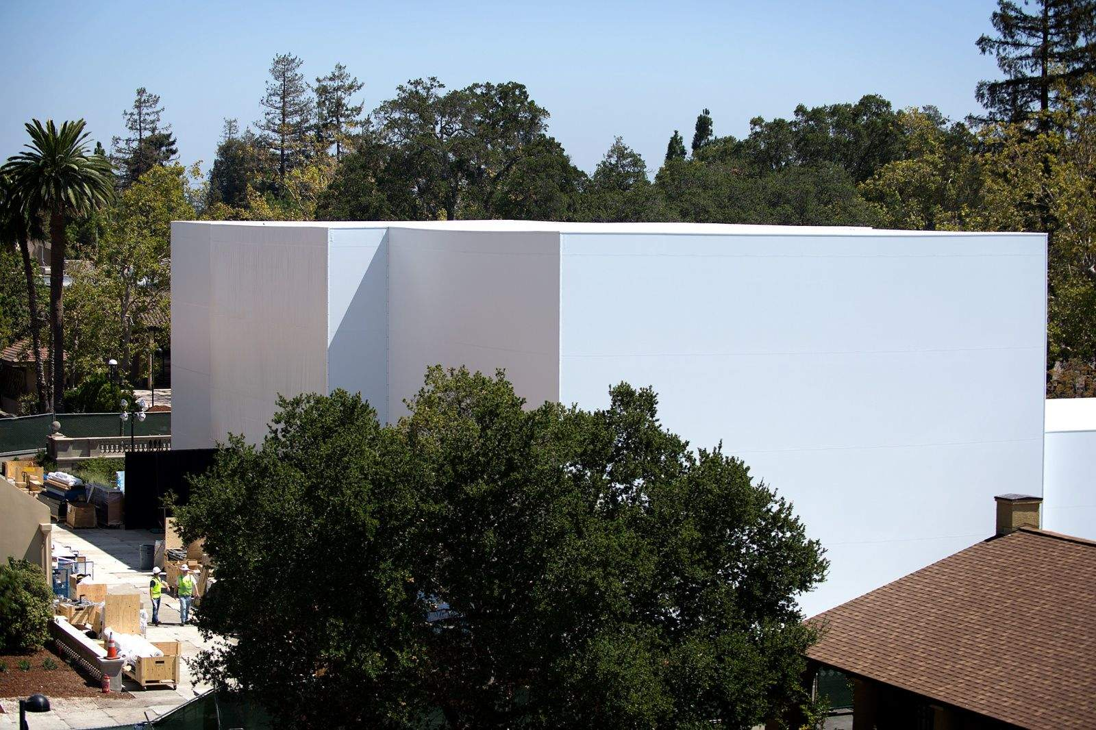 CUPERTINO, California -- What's inside the mystery building Apple is fabricating for its big September 9 event? The giant construction project is almost as big of an enigma as what the iWatch will actually look like or do.   The boxy structure, which sprang up behind the Flint Center for the Performing Arts here on the De Anza College campus, looks like a cross between an igloo and a winning confection on Cake Wars.  Naturally, the enormous two-to-three story building sparked intense curiosity among the Apple faithful when pictures emerged Thursday, so we had to go take a look for ourselves.   Will it hold something as mundane as a demo area where tech journalists can fondle Apple's latest, greatest gear? Does it contain a full-size home of the future to show off amazing HomeKit implementations? Will it house a runway for an Apple wearables fashion show or a giant stage for a post-announcement Dr. Dre concert?   Whatever it holds, it is truly a massive undertaking. It's surrounded by green fences and countless security guards. We, like you, can't wait for Apple's big reveal — here's what we saw walking around the outskirts of the secretive project Thursday afternoon.