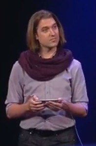Tommy Krul's scarf threatened to overshadow almost everything at Tuesday's keynote. Screengrab: Cult of Mac