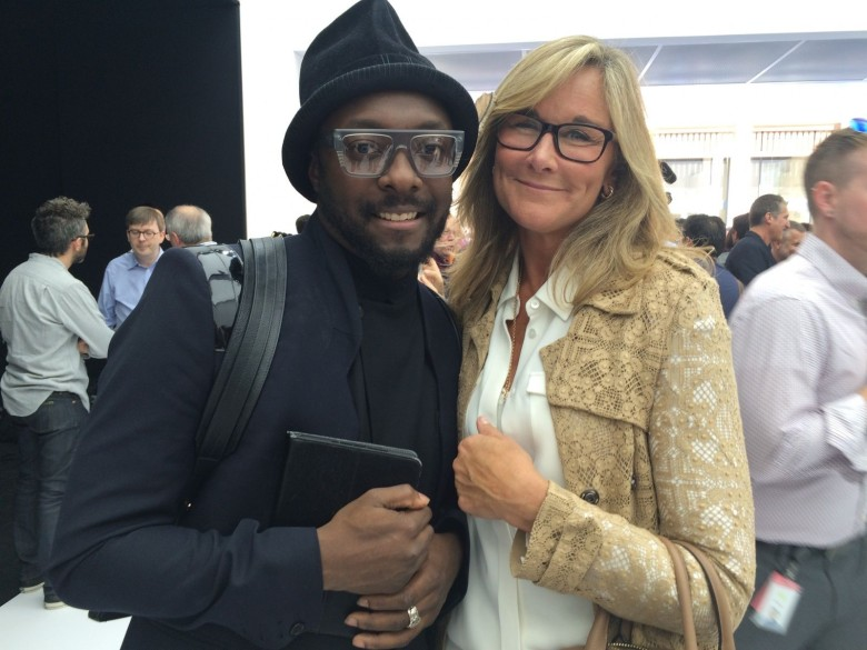 Apple retail chief Angela Ahrendts with poster Will.i.am  at the Apple Watch unveiling in 2014.