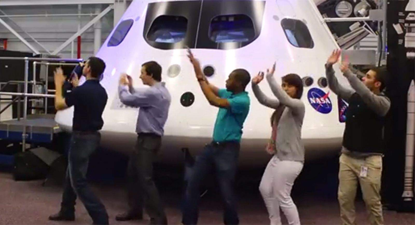 A dance line of NASA interns from a scene in their parody music video called