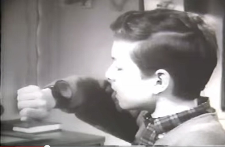 A child calls a buddy on his Dick Tracy Two-Way Wrist Radio in this 1960s commercial.