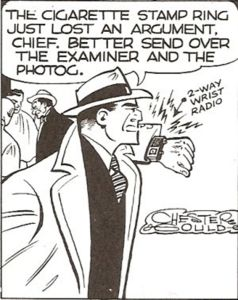 Detective Dick Tracy calling the chief on his wrist radio in a panel from Chester Ghould's comic strip.