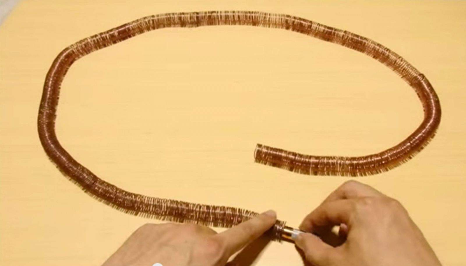 Transform copper wire, magnets and a battery into a simple electric train. Screen grab from Amazing Science YouTube video