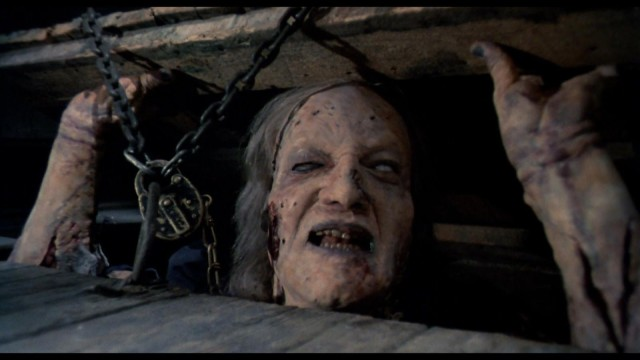 Because it's a Sam Raimi film, his brother Ted has to be in it. Here, he plays an old possessed woman locked in the fruit cellar. Photo: Paramount Pictures
