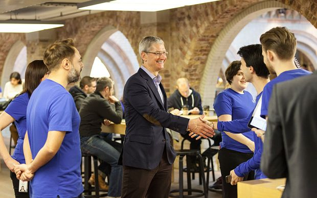 Tim Cook greeting employees this morning in London. Photo: Kensington Leverne