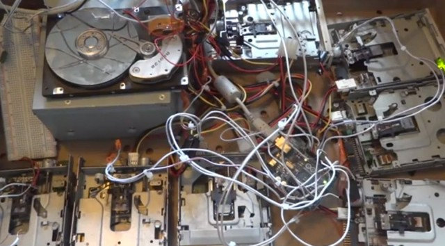 Arganalth's original orchestra of drives for making music before using a smaller computer to make a more portable setup. Photo: Arganalth/YouTube