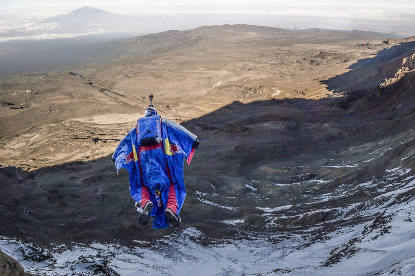 Russian BASE jumper Valery Rozov leaves his team behind after a recent wingsuit flight from Mount Kilimanjaro in Africa. Photo:  Thomas Senf / Red Bull Content Pool