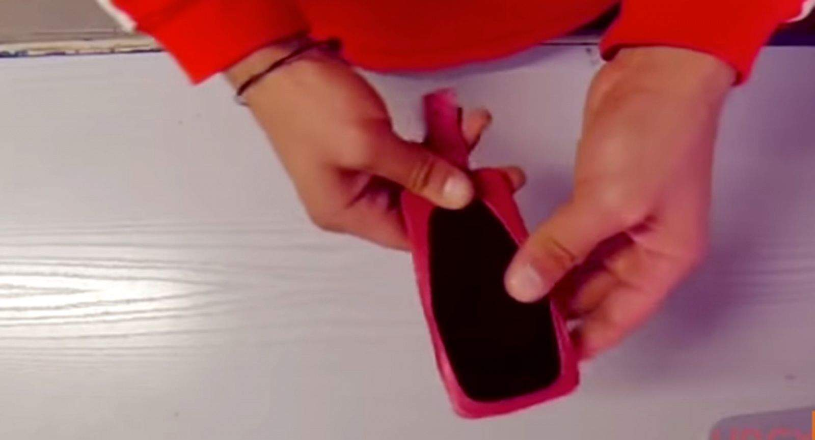 A balloon can make a quick iPhone cover in a pinch, but is not recommended. Photo: Storyful/YouTube