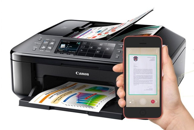 A Canon desktop scanner for at home, and an iPhone 6 for on-the-go. Photo: Cult of Mac