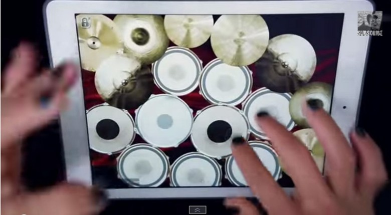 The fingers of Apple Man keeps up to Marilyn Manson's The Beautiful People. Photo: Apple Man/YouTube