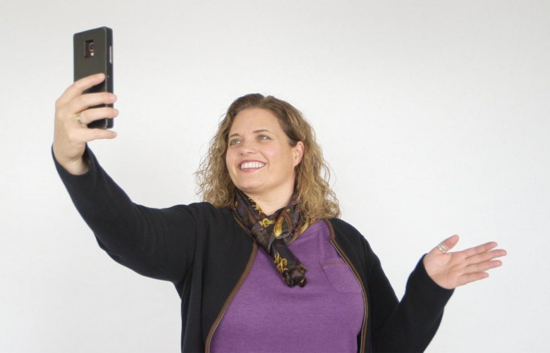 Elliptic Labs CEO Laila Danielsen shows how simple hand gestures can activate her smartphone's camera. Photo: Elliptic Labs
