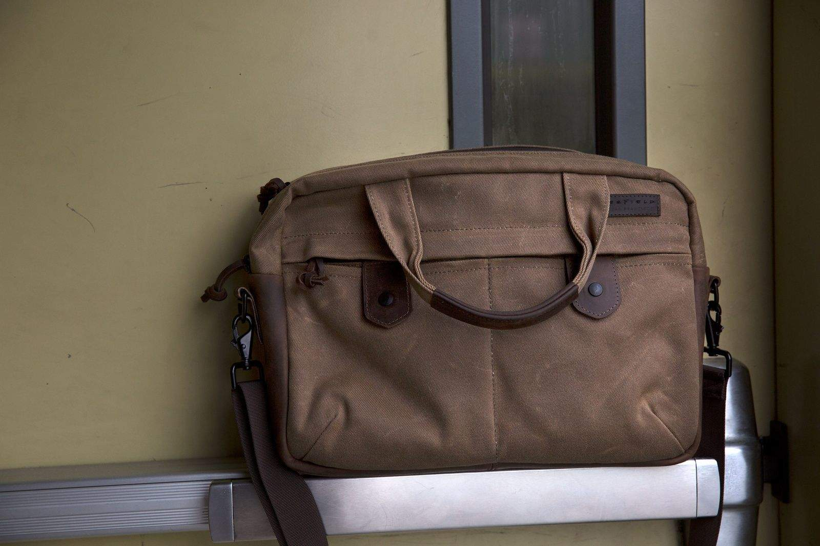 WaterField Designs' Bolt briefcase is not for hoarders who want to carry every infernal gadget with them everywhere they go. Like the impossibly thin new MacBook, it's stripped down to the essentials — and the essentials are stylish, sturdy and compelling.   The $249 Bolt will surprise you with its slimness. It comes in two sizes — the small one I tested holds up to a 13-inch MacBook Air (the larger model holds up to a 17-inch laptop). After sliding in an 11-inch Air, an iPad and an envelope full of documents, the Bolt was fairly full; there was barely room to toss in a pair of headphones.    But that's the point of the Bolt. It's designed for carting around your must-have gear in a sleek, pleasing package. The brown waxed canvas bag looked good out of the gate (and even better after a few trips gave it more character). The chocolate leather accents, including a thick bottom that's perfect for keeping grime at bay, seem like they will only look better over time.   The craftsmanship employed by the San Francisco bag maker is evident from the first zip of the Bolt's hefty, waterproof zipper or the first flip of the
