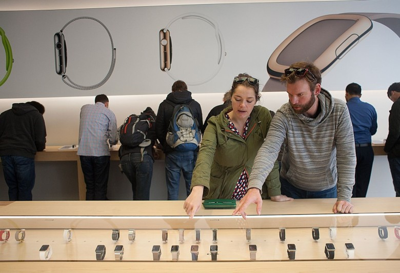 Mel Togusen, left, and her friend,  Chris Brown, look at different styles of Apple Watches. Photo: David Pierini/Cult of Mac