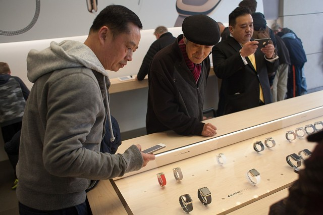 An Apple fan takes an iPhone photo of two gold Apple Watches on display. Photo: David Pierini/Cult of Mac