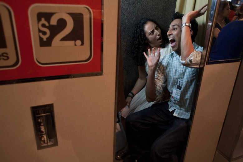 Sam Pidilla and Violeta Tayeh strike a spirited pose inside a photo booth during an international convention of photo booth enthusiast in Chicago. Photo: David Pierini/Cult of Mac