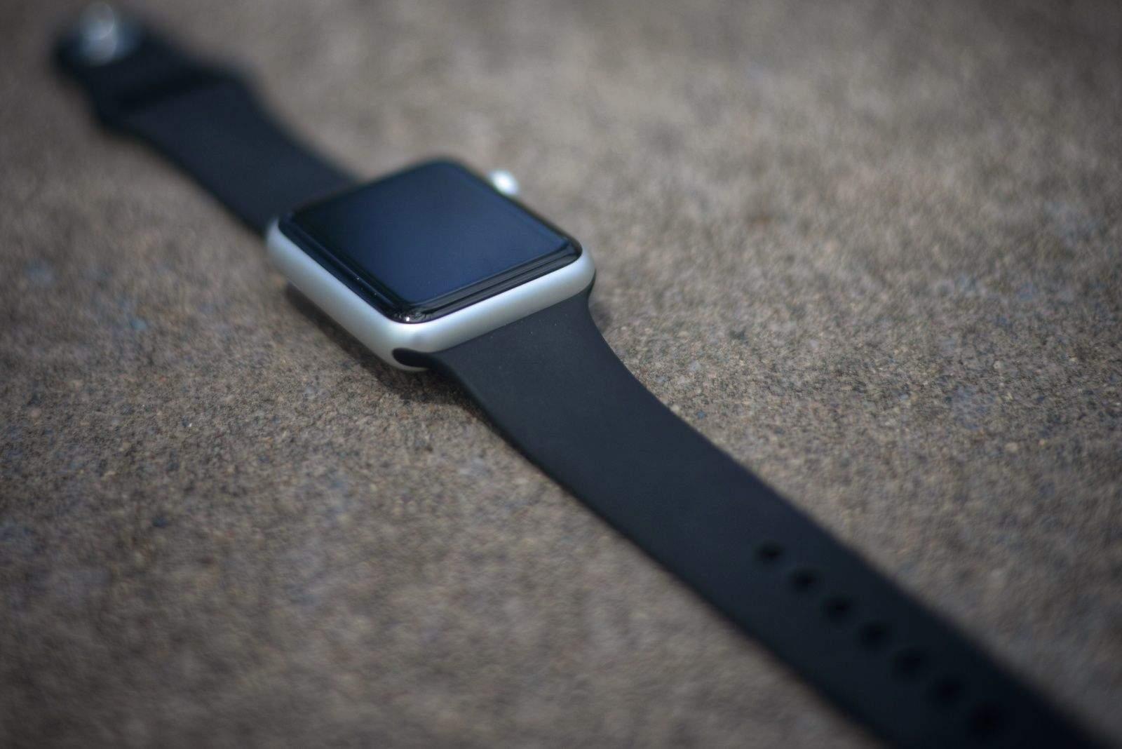 Apple Watch sport with black fluoroelastomer band.