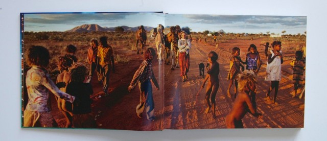 A double-truck photo of Robyn Davidson meeting up with Aborignal children during her journey across the Australian Outback. Photo: Rick Smolan/Against All Odds Production