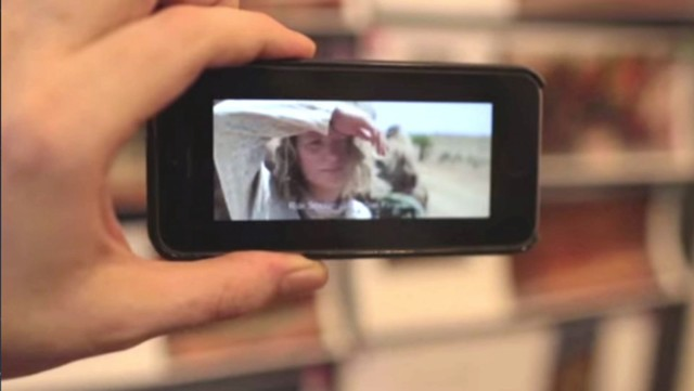 With the Aurasma app, a reader of INSIDE TRACKS can point the phone at a picture and view a corresponding scene from the movie, TRACKS. Photo: Against All Odds Productions/YouTube