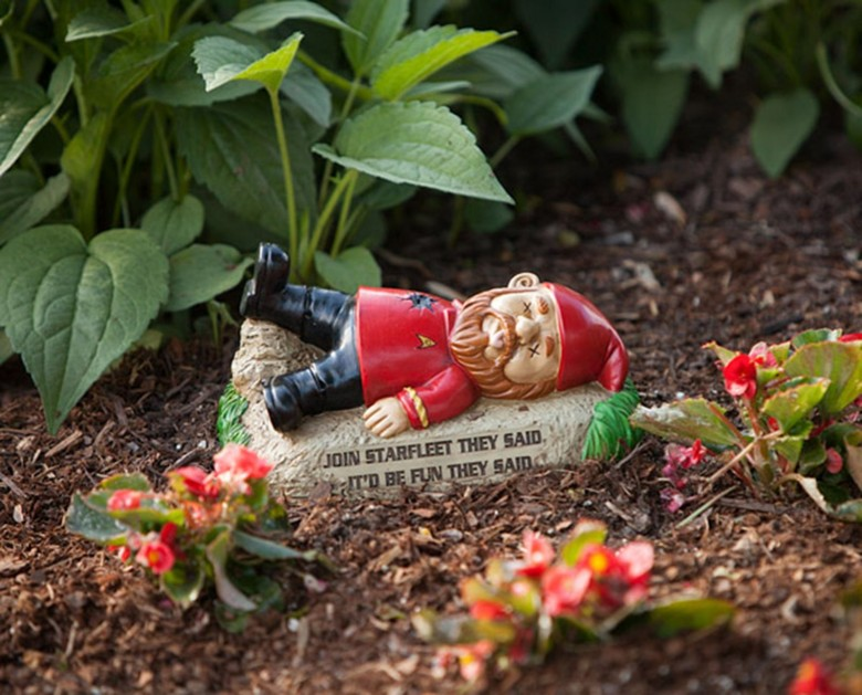 Even in a red shirt, a garden gnome is not safe.